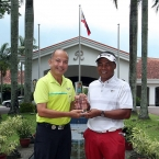 mr tabueena -ECI pres awarede the trophy to mr elmer slvador 2015 champion riviera classic