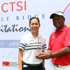 ms bambi marfil-ictsi, asst.pr manager awards the champion trophy to mr tony lascuna