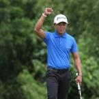 dino villanueva raise his handas after a berdie in hole 8