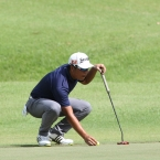 alido checking his allignment in hole 1