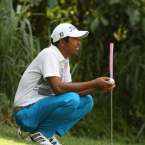 ferdie aunzo in the shades area and while waiting for is turn in hole 15