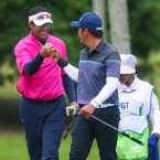 quiban and rhounin fist bump in hole 17