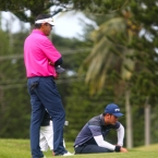 quiban study his line in hole 14 while rhounimi watching in